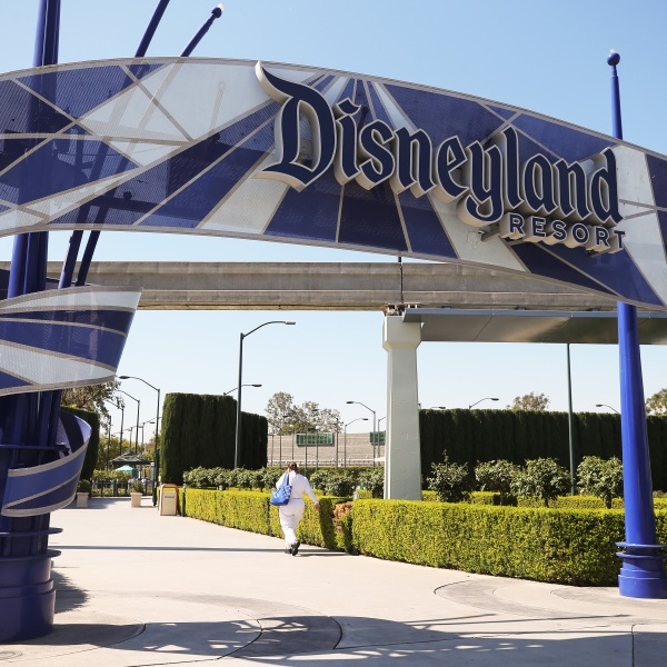 A person walks into an entrance to Disneyland in Anaheim on Sept. 30, 2020, after Disney said it was laying off 28,000 workers amid the toll of the COVID-19 pandemic on theme parks. (Mario Tama / Getty Images)