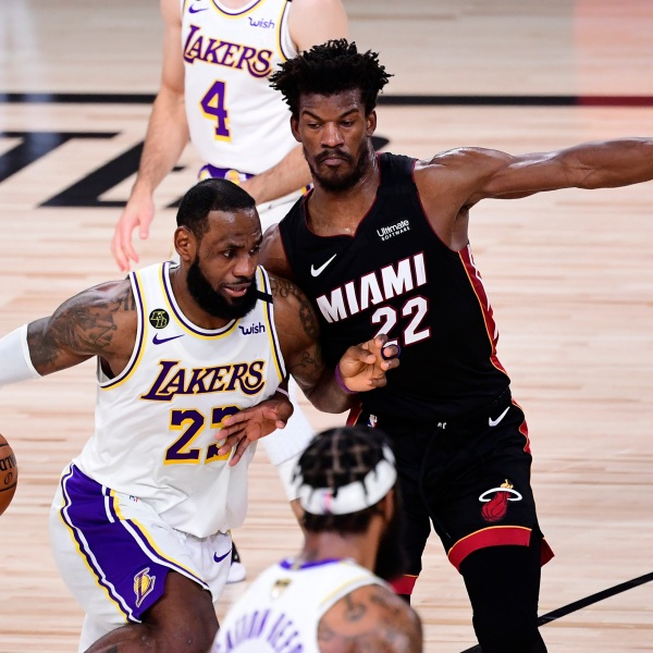 LeBron James of the Los Angeles Lakers drives to the basket against Jimmy Butler of the Miami Heat during Game 3 of the 2020 NBA Finals at AdventHealth Arena at ESPN Wide World of Sports Complex on Oct. 4, 2020 in Lake Buena Vista, Florida. (Douglas P. DeFelice/Getty Images)