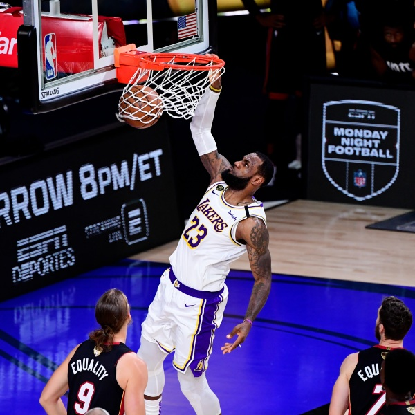 LeBron James #23 of the Los Angeles Lakers dunks the ball during the third quarter against the Miami Heat in Game Six of the 2020 NBA Finals at AdventHealth Arena at the ESPN Wide World Of Sports Complex on Oct. 11, 2020 in Lake Buena Vista, Florida. (Douglas P. DeFelice/Getty Images)