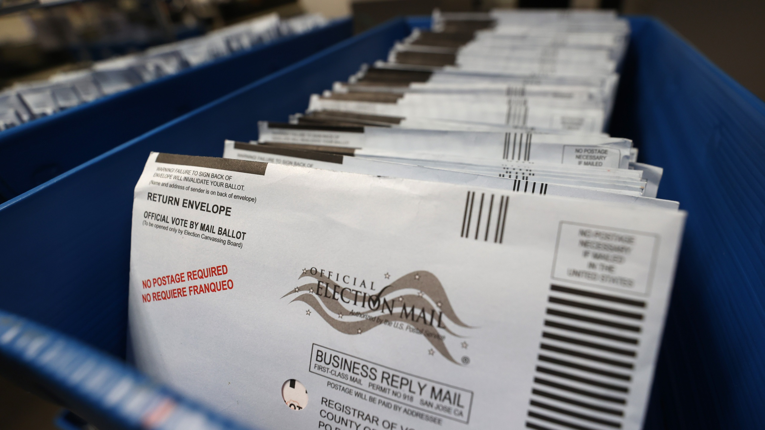 Mail-in ballots sit in trays before being sorted at the Santa Clara County registrar of voters office on Oct. 13, 2020 in San Jose, California. (Justin Sullivan/Getty Images)
