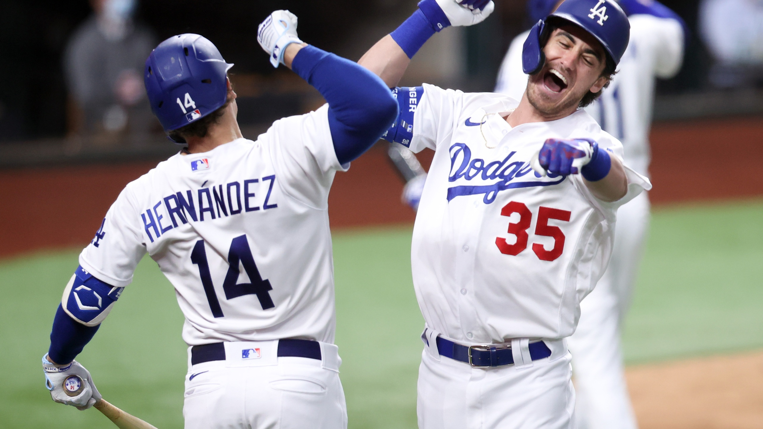 Cody Bellinger #35 of the Los Angeles Dodgers is congratulated by Enrique Hernandez #14 after hitting a solo home run against the Atlanta Braves during the seventh inning in Game Seven of the National League Championship Series at Globe Life Field on Oct. 18, 2020 in Arlington, Texas. (Tom Pennington/Getty Images)