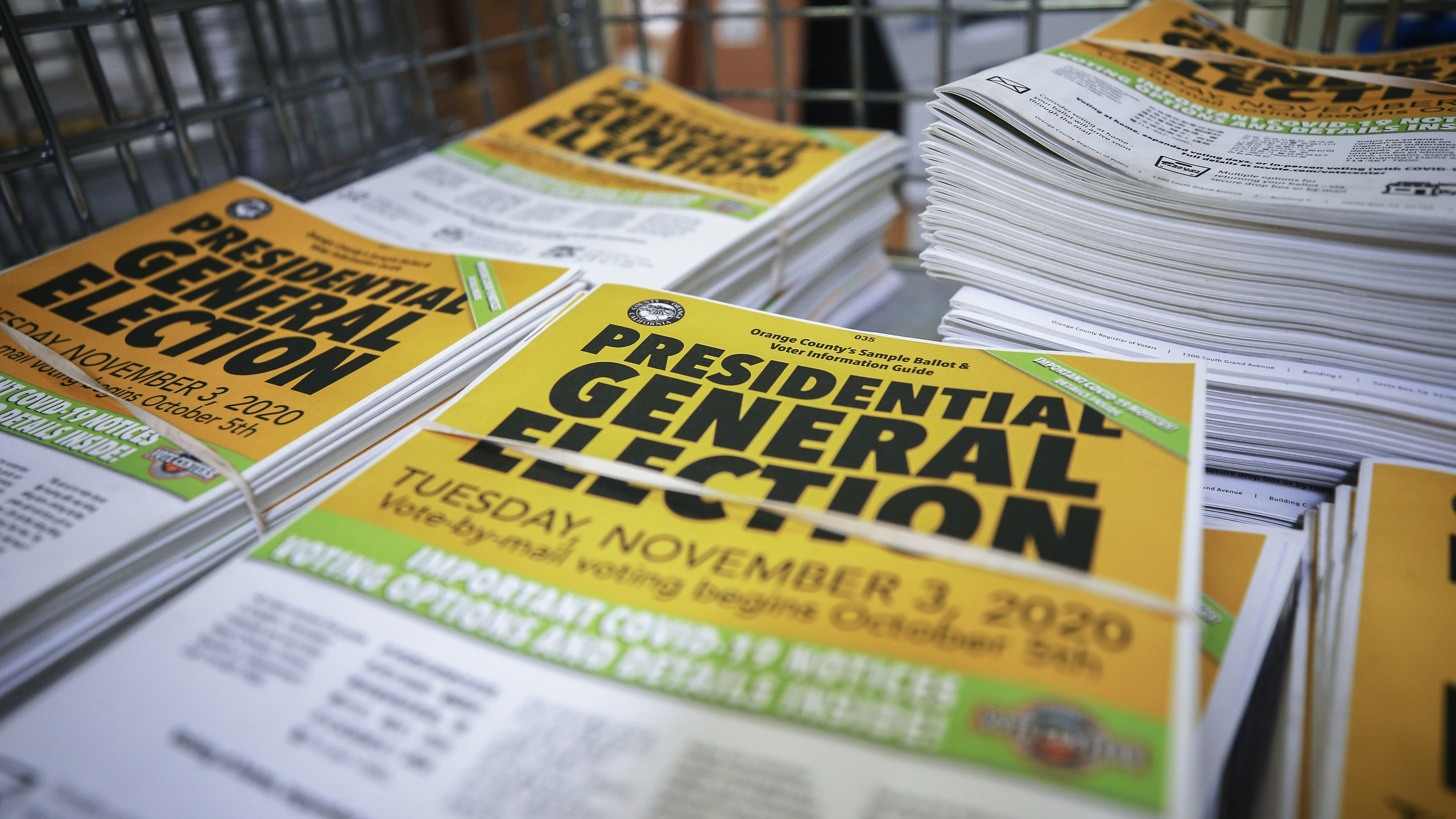 Voter information guides sit bundled at the Orange County Registrar of Voters on Oct. 19, 2020, in Santa Ana. (Mario Tama/Getty Images)