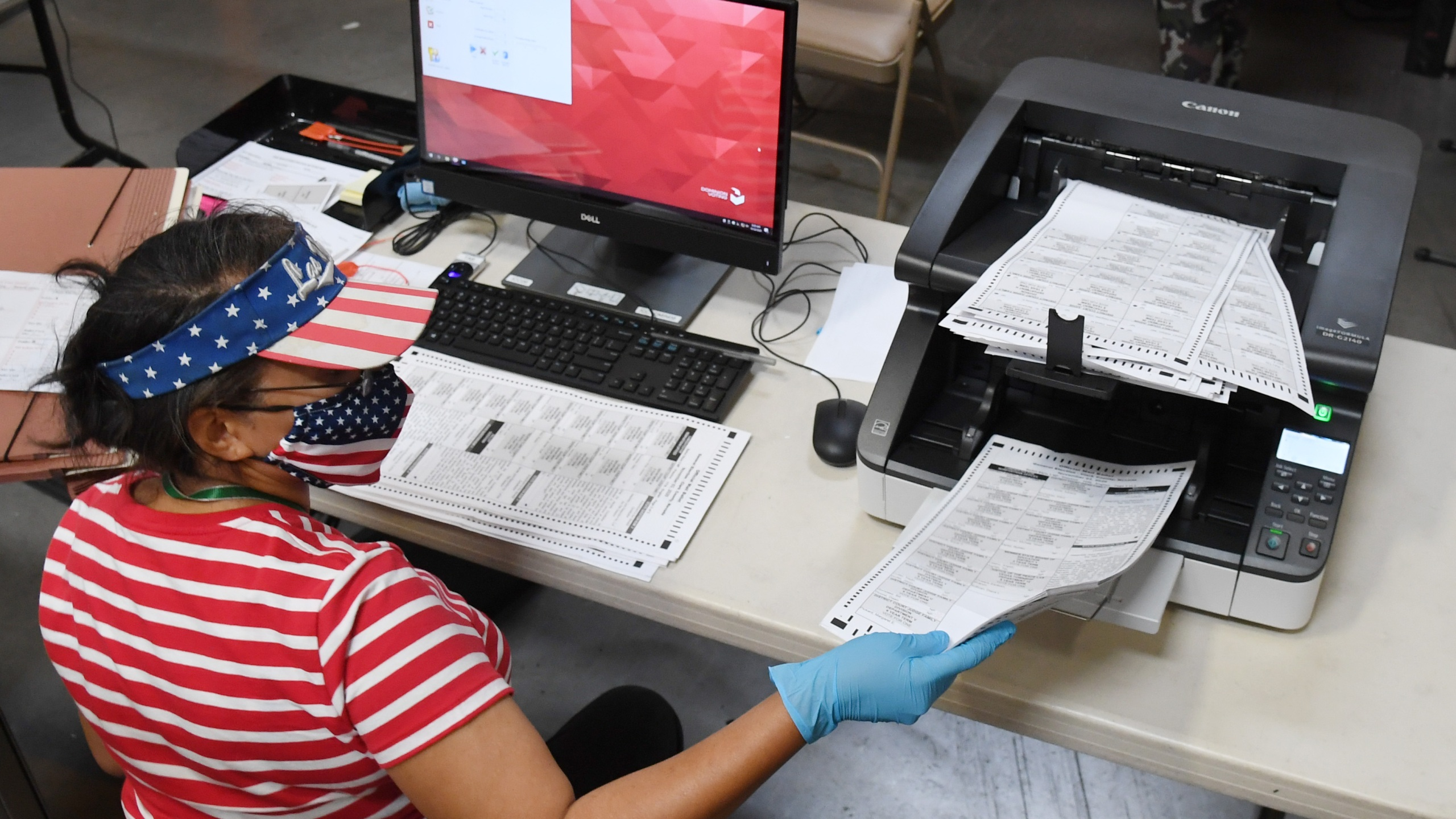A Clark County election worker scans mail-in ballots at the Clark County Election Department on Oct. 20, 2020, in North Las Vegas, Nevada. In-person early voting for the general election in the battleground state began on Oct. 17 and continues through Oct. 30. Earlier this year, Nevada Gov. Steve Sisolak signed a bill mandating that all registered voters in the state receive a mail-in ballot for the first time to help keep people safe from the coronavirus (COVID-19). (Ethan Miller/Getty Images)
