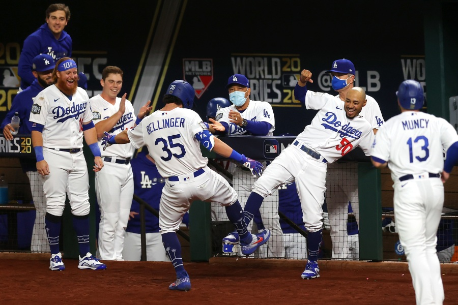 Cody Bellinger of the Los Angeles Dodgers is congratulated by Mookie Betts after hitting a two-run home run against the Tampa Bay Rays during Game One of the World Series in Arlington, Texas, on Oct. 20, 2020. (Ronald Martinez / Getty Images)