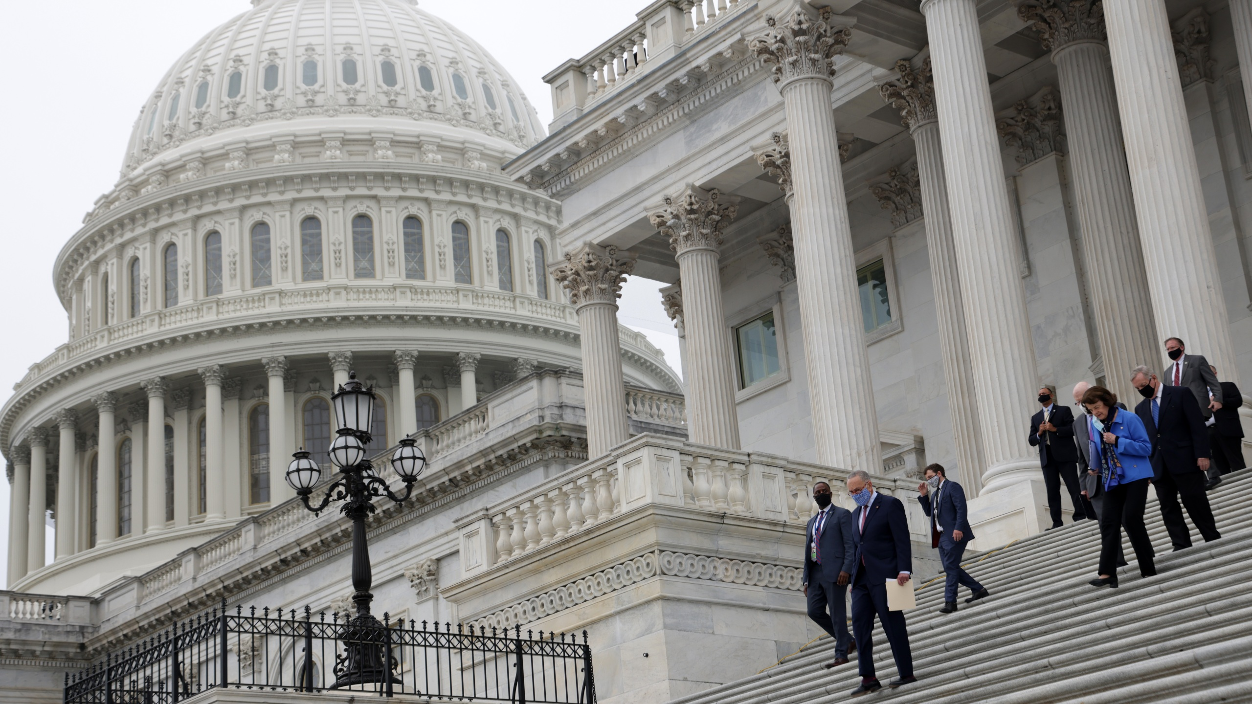 Democratic members of U.S. Senate Judiciary Committee walk down the east front steps of the U.S. Capitol for a news conference on Oct. 22, 2020 in Washington, DC. (Alex Wong/Getty Images)