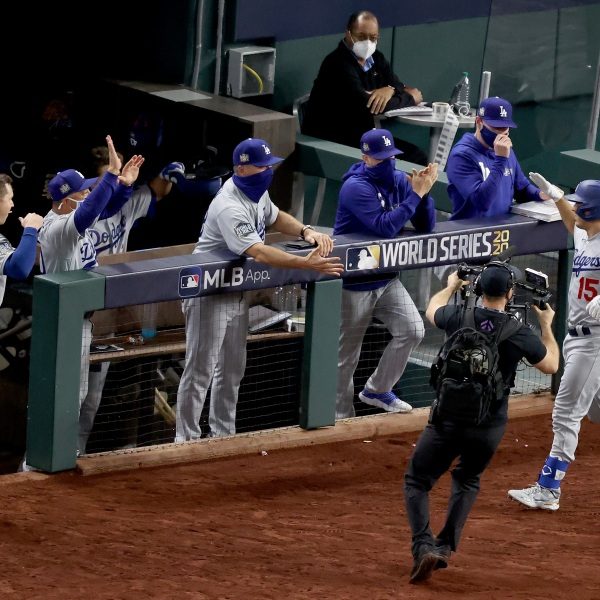 Austin Barnes #15 of the Los Angeles Dodgers is congratulated by his teammates after hitting a solo home run against the Tampa Bay Rays during the sixth inning in Game Three of the 2020 MLB World Series at Globe Life Field on Oct. 23, 2020 in Arlington, Texas. (Tom Pennington/Getty Images)