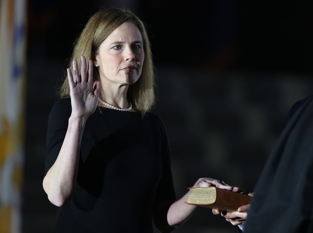 U.S. Supreme Court Associate Justice Amy Coney Barrett is sworn in by Supreme Court Associate Justice Clarence Thomas during a ceremonial swearing-in event on the South Lawn of the White House Oct. 26, 2020 in Washington, D.C. (Tasos Katopodis/Getty Images)