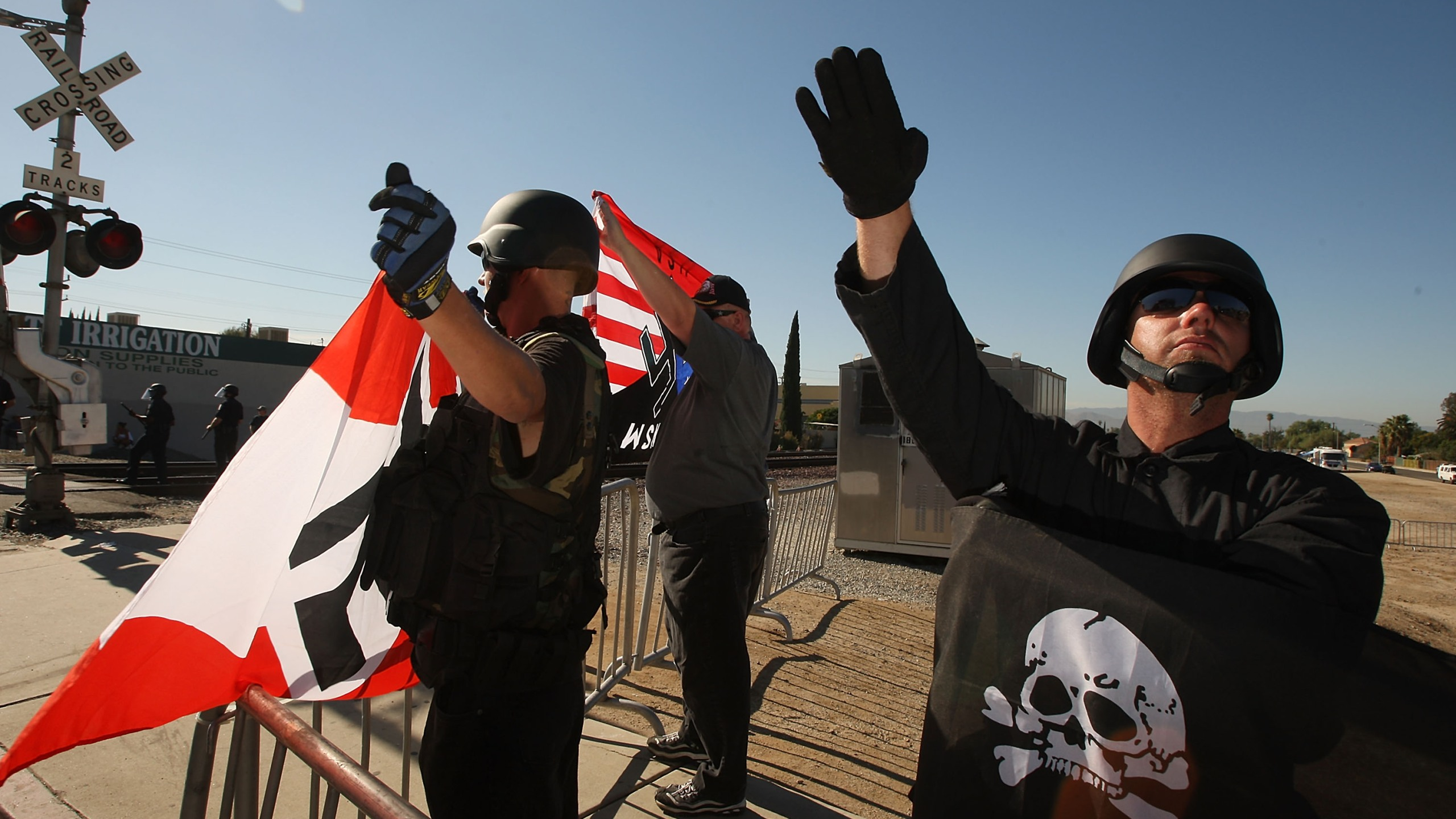 Members of the white supremacist group, the National Socialist Movement, hold swastika flags and salute at the NSMÕs anti-illegal immigration rally near a Home Depot store on October 24, 2009 in Riverside, California. (David McNew/Getty Images)Members of the white supremacist group, the National Socialist Movement, hold swastika flags and salute at the NSMÕs anti-illegal immigration rally near a Home Depot store on October 24, 2009 in Riverside, California. (David McNew/Getty Images)