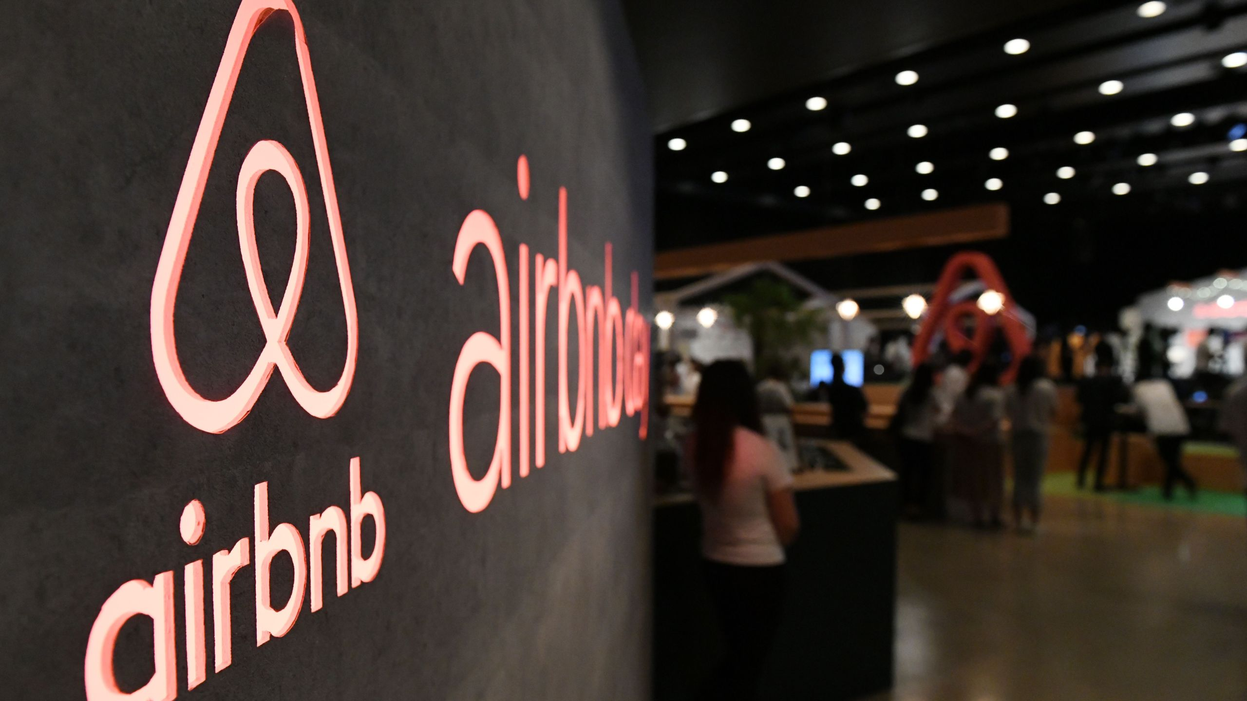Airbnb's logo is displayed during the company's press conference in Tokyo on June 14, 2018. (TOSHIFUMI KITAMURA/AFP via Getty Images)