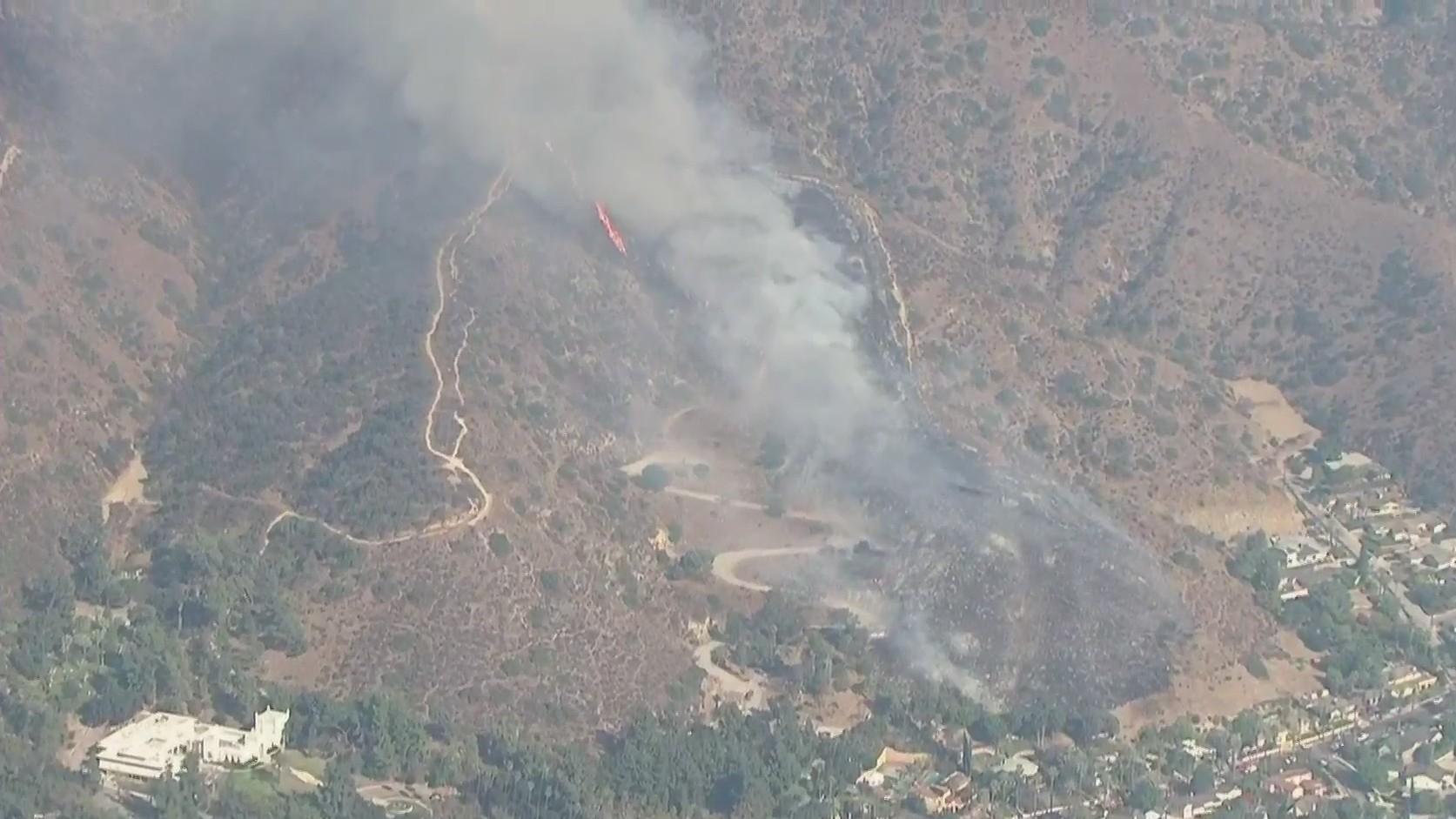 A brush fire spreads near Brand Park in Glendale on Oct. 27, 2020. (KTLA)