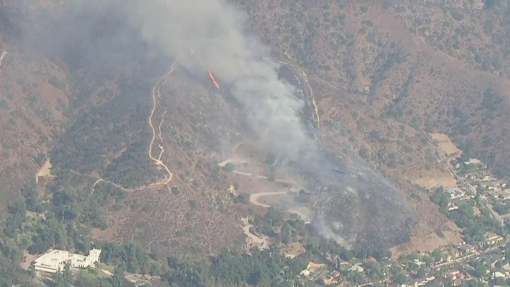 A brush fire spreads near Brand Park in Glendale on Oct. 27, 2020. (KTLA)
