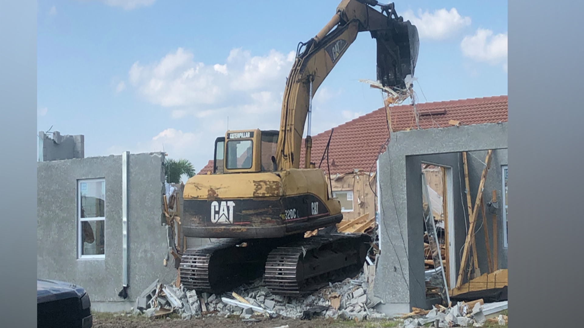 Builder Ashton Woods demolished a brand new home in Bradenton, Fla. after building it too close to the neighbor's home. (Photo courtesy: WFLA)