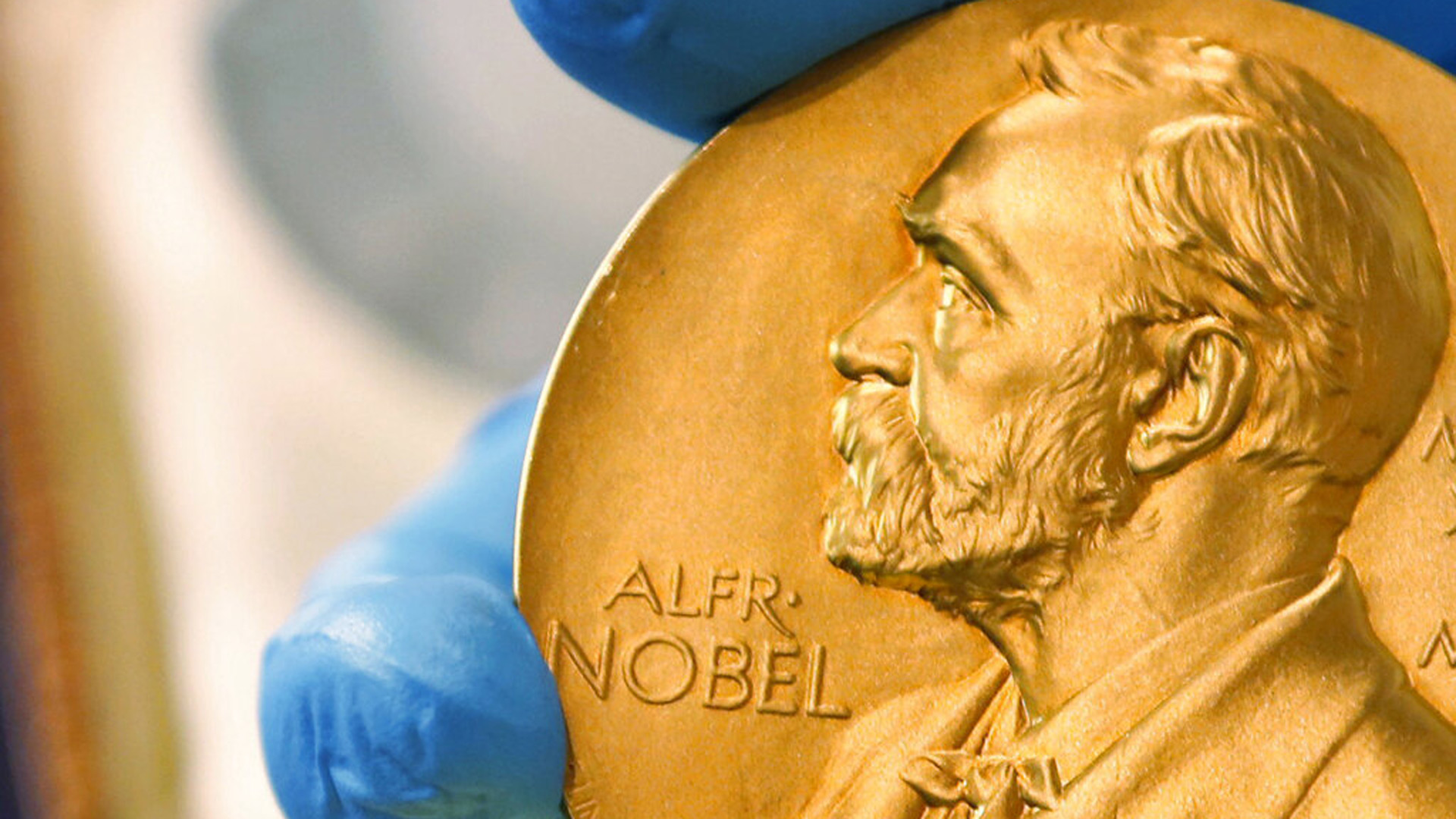 In this April 17, 2015 file photo, a national library employee shows a gold Nobel Prize medal in Bogota, Colombia. (AP Photo/Fernando Vergara, File)