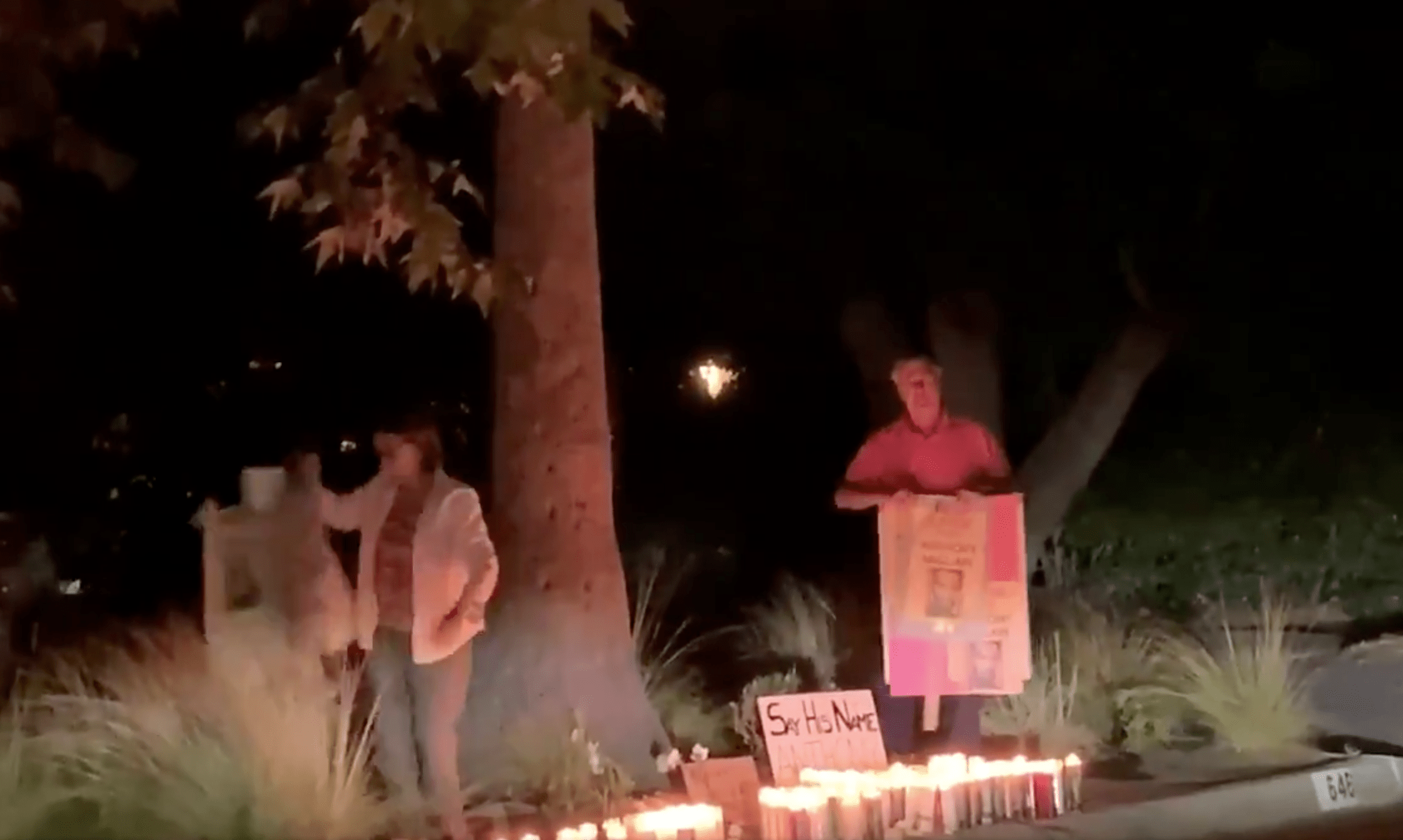 Video posted to Twitter appears to show the mayor of Pasadena removing signs from a vigil for Anthony McClain on Oct. 24, 2020. (Sean Carmitchel)