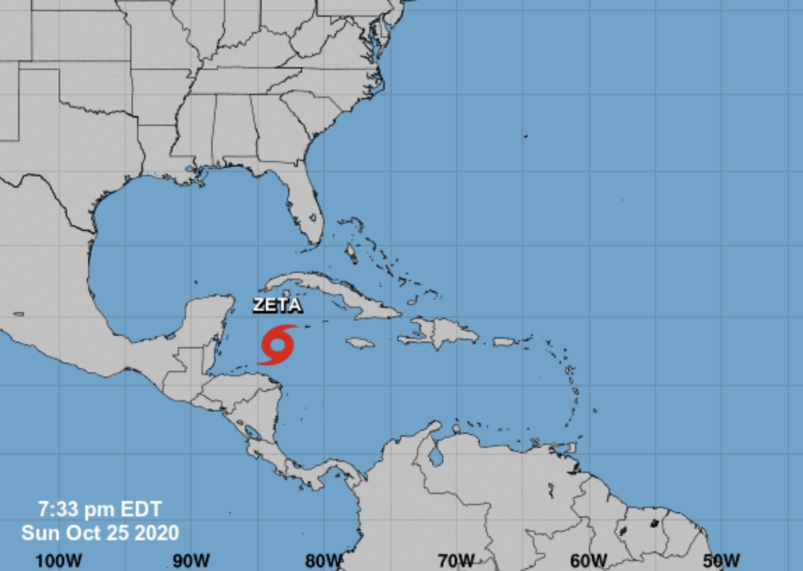 This image from the National Hurricane Center, updated as of Sunday evening Oct. 25, 2020, shows the current location of Tropical Storm Zeta as it strengthens into a hurricane while moving toward the Gulf Coast.