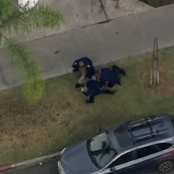 Officers detain a pursuit suspect in the Long Beach area on Oct. 30, 2020. (KTLA)