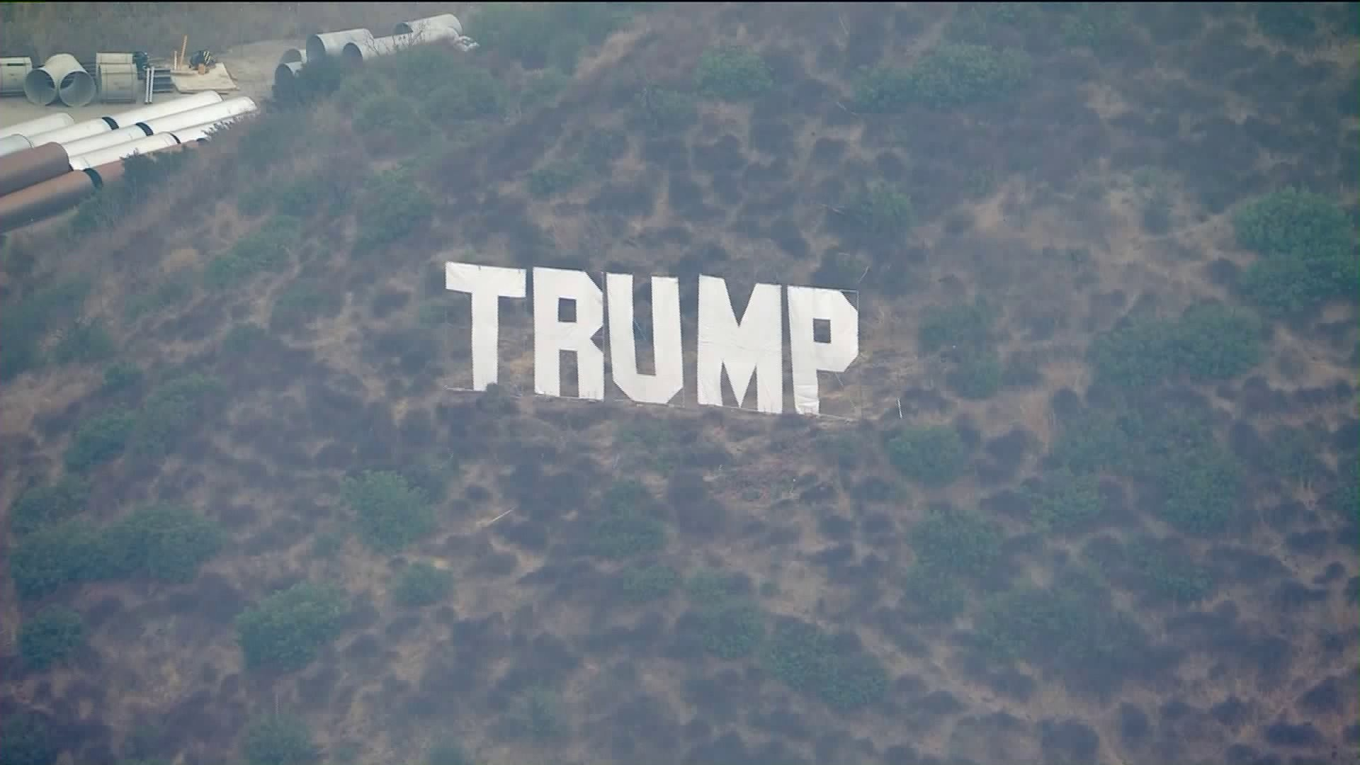 A Trump sign, comprised of Hollywood-sign style lettering, appeared on the 405 Freeway in the Sepulveda Pass on Oct. 6, 2020. (KTLA)