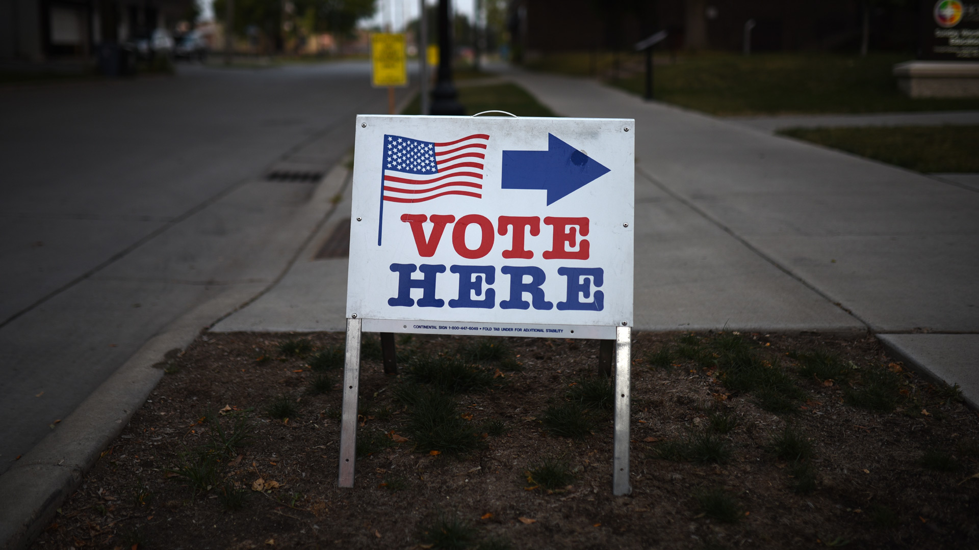 "A sign reading ""Vote Here"" points toward a polling place in Minneapolis, Minnesota. (Stephen Maturen/Getty Images)"