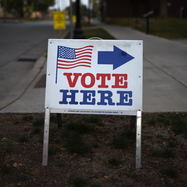 """A sign reading """"Vote Here"""" points toward a polling place in Minneapolis, Minnesota. (Stephen Maturen/Getty Images)"""