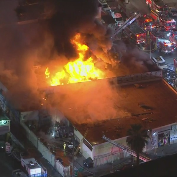 Crews respond to a fire burning in downtown Los Angeles on Oct. 13, 2020. (KTLA)