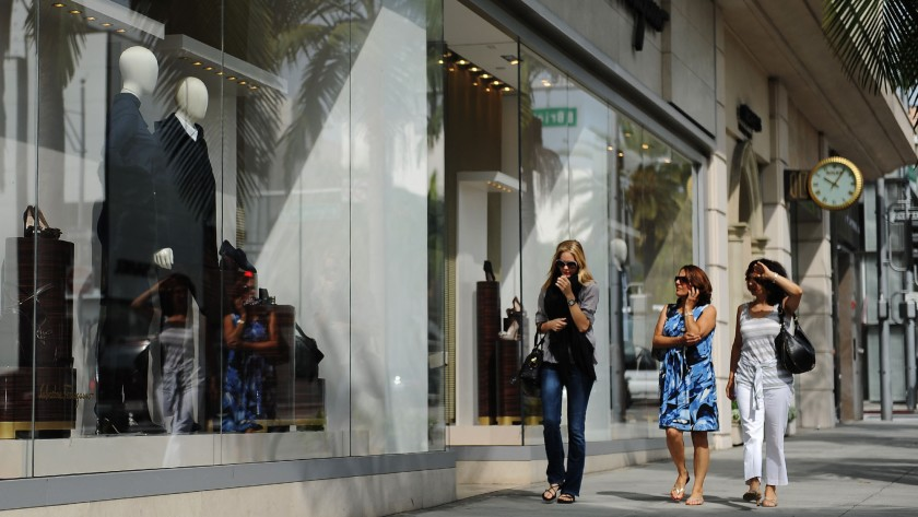 Shoppers along Rodeo Drive in Beverly Hills look into the Salvatore Ferragamo store in 2011.(Mariah Tauger / Los Angeles Times)
