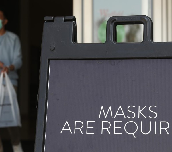 A sign tells customers to wear masks to prevent the spread of COVID-19 as shoppers return to indoor shopping at the Westfield Santa Anita shopping mall in Arcadia on Wednesday, the first day L.A. County malls were allowed to reopen at limited capacity.(Genaro Molina / Los Angeles Times)
