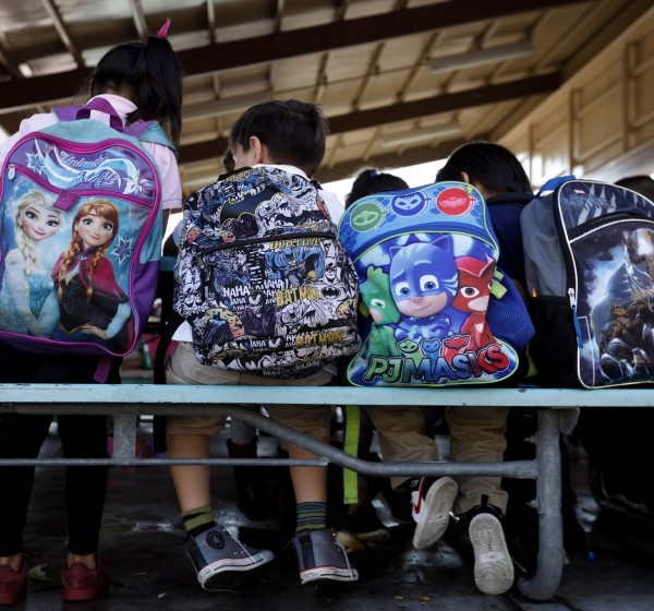 Students sit at tables after school at Telfair Elementary in Pacoima, which serves a high percentage of homeless students. (Francine Orr / Los Angeles Times)