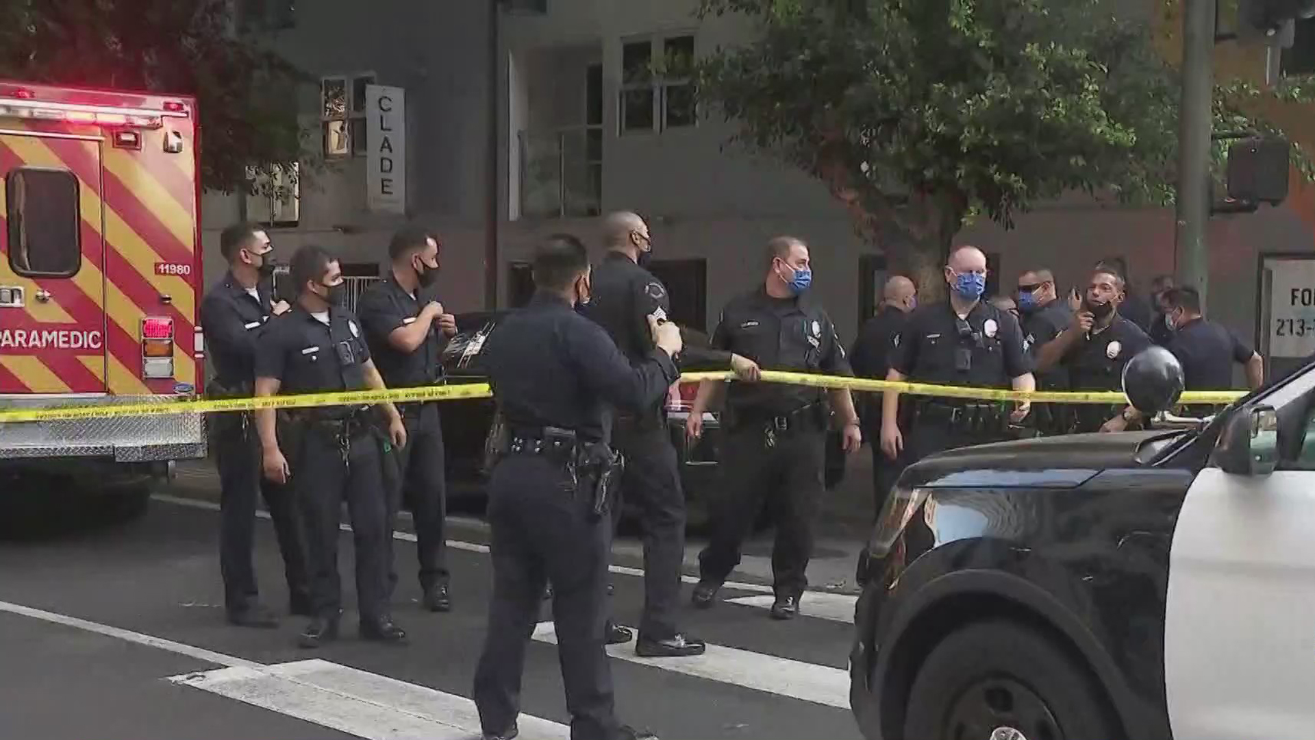 Police stand at the scene where a chase ended following a carjacking that involved a baby and grandmother in downtown L.A. on Oct. 17, 2020. (KTLA)
