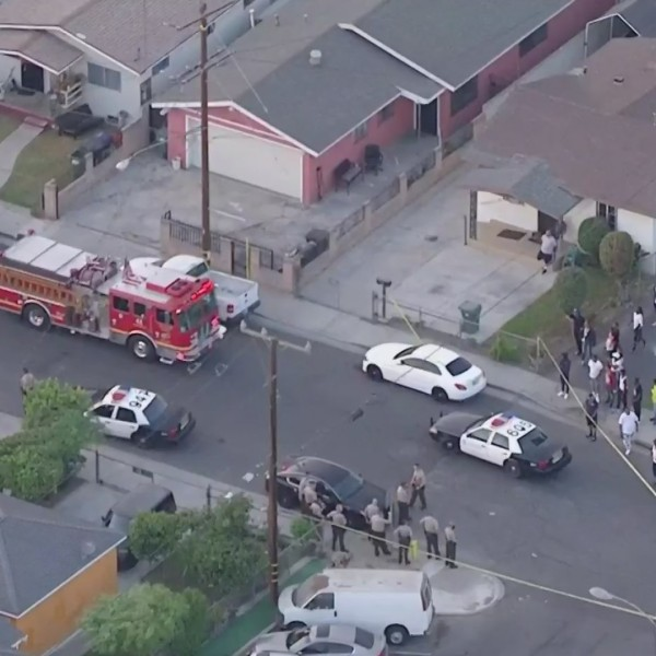 Authorities respond to the scene where deputies fatally shot a man in Willowbrook on Oct. 16, 2020. (KTLA)