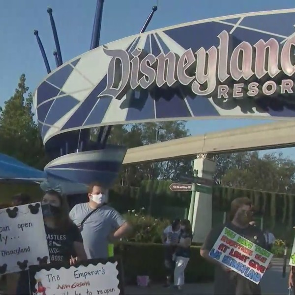 Laid-off Disneyland workers and their supporters rally in Anaheim on Oct. 17, 2020 to push for the park's reopening. (KTLA)