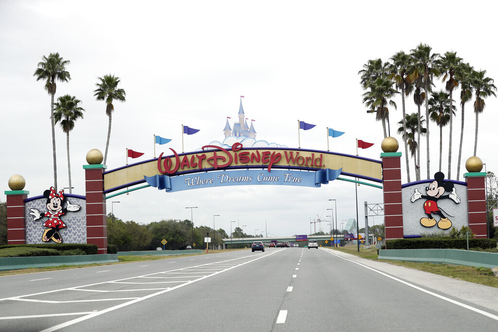 The road to the entrance of Walt Disney World has few cars Monday, March 16, 2020, in Lake Buena Vista. (AP Photo/John Raoux)