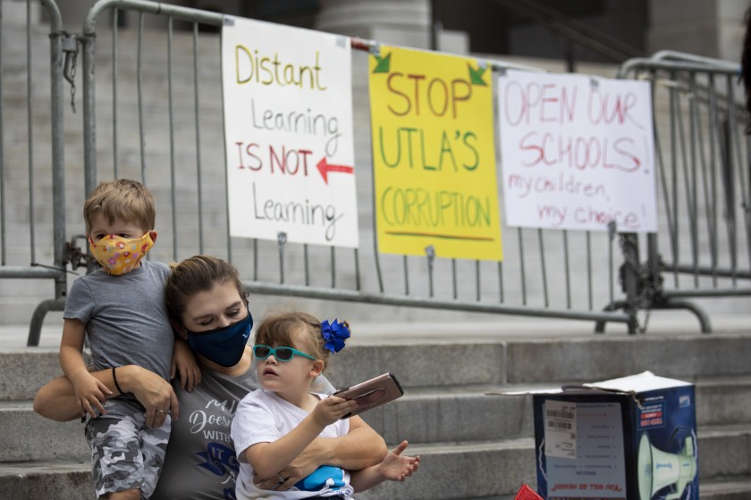 San Pedro resident Jodi Hughes and her children, ages 3 and 5, joined other families for an Open Our Schools rally at L.A. City Hall on Oct. 25, 2020. (Francine Orr / Los Angeles Times)