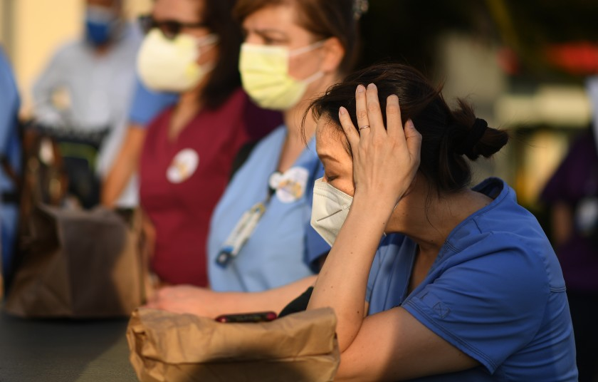Nurses attend a candlelight vigil for nurse Celia Marcos outside Hollywood Presbyterian Medical Center in Los Angeles Wednesday. Marcos died from the coronavirus.(Wally Skalij / Los Angeles Times)