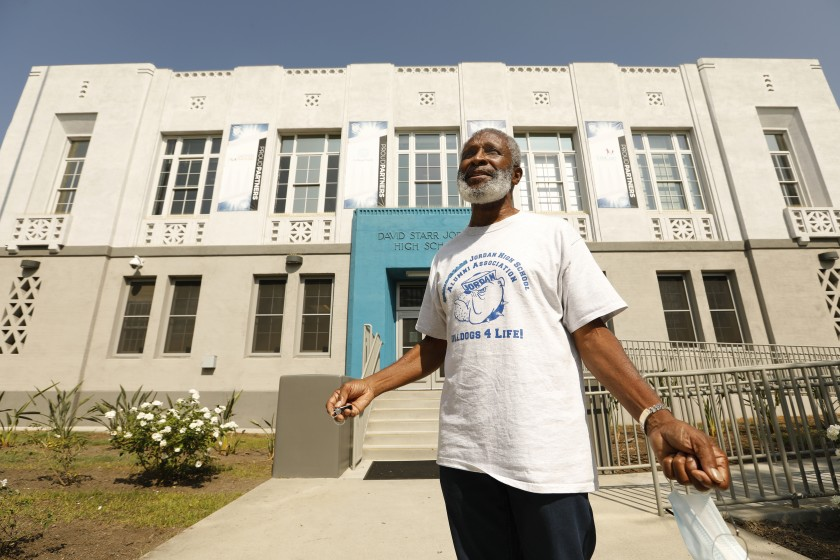 Earl Allen, president of the Jordan High School Alumni Association, in front of his remodeled alma mater, which is shedding its association with a college president who promoted eugenics.(Carolyn Cole / Los Angeles Times)