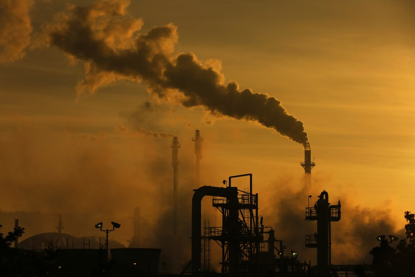 A refinery in the Wilmington neighborhood of Los Angeles is among the facilities regulated under California's cap-and-trade program to reduce greenhouse gas emissions. (Rick Loomis / Los Angeles Times)