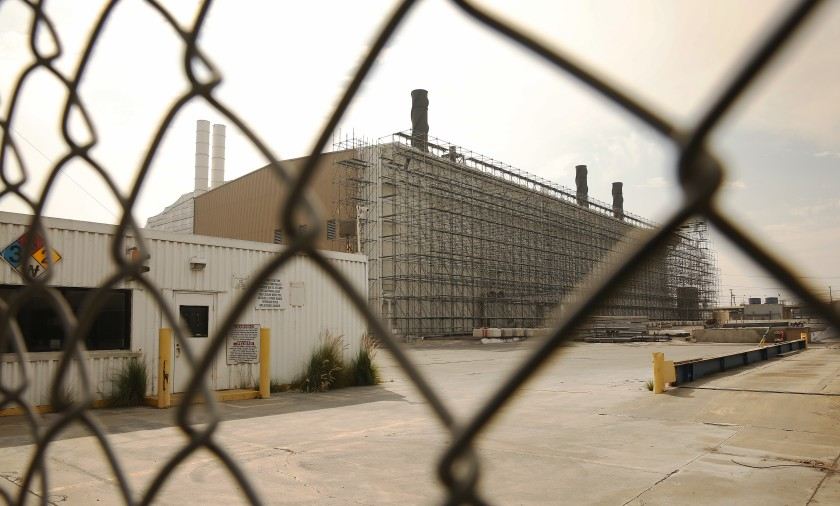 Portions of the former Exide lead-acid battery recycling plant in Vernon are now wrapped in scaffolding and white plastic sheeting.(Al Seib / Los Angeles Times)