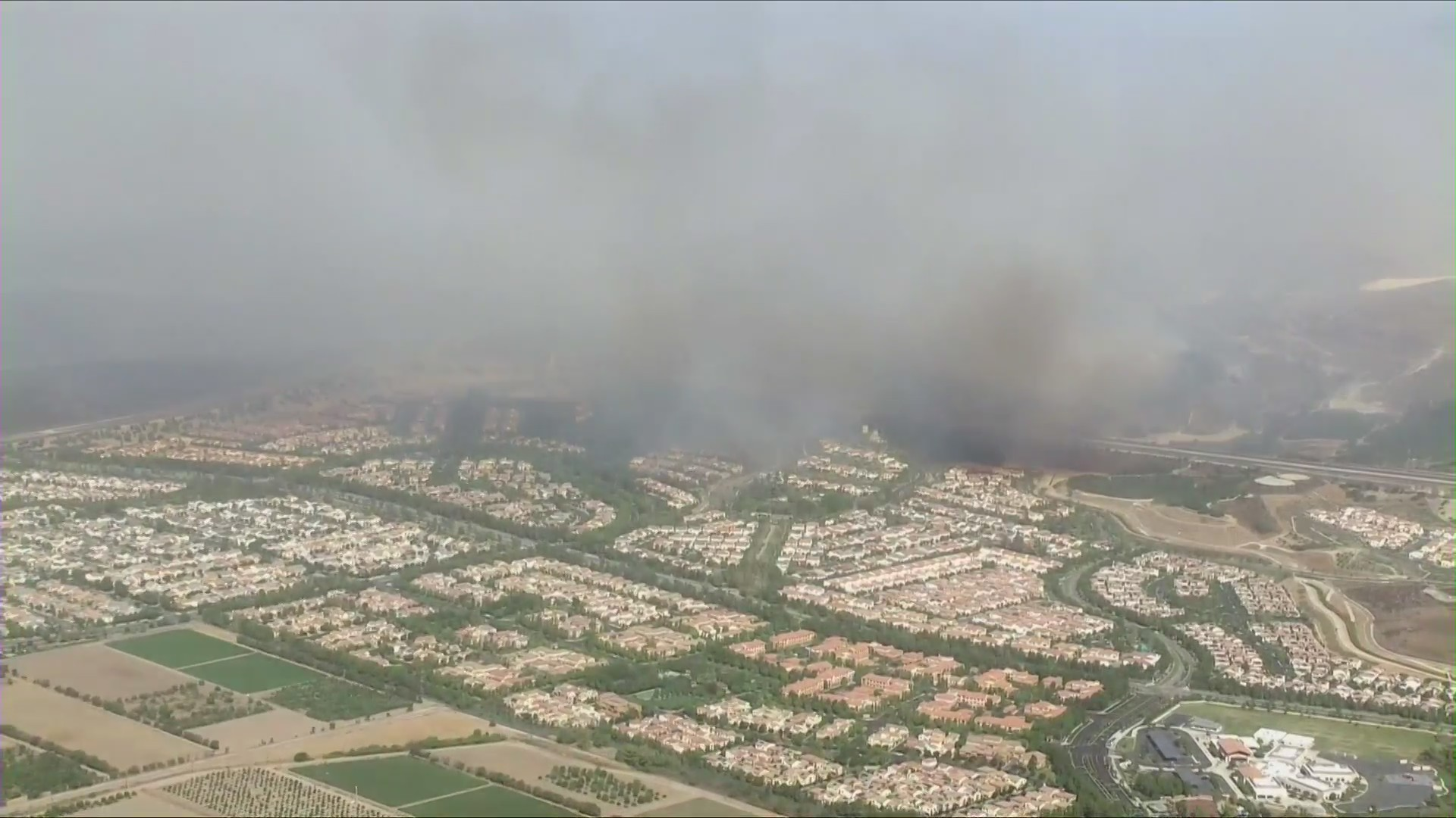 Smoke from the Silverado Fire rises over Irvine and the surrounding area on Oct. 26, 2020. (Sky5)