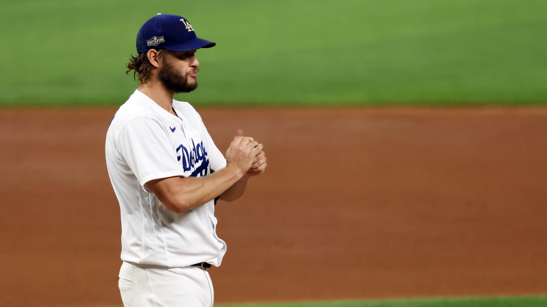 Clayton Kershaw of the Los Angeles Dodgers reacts during the fourth inning against the San Diego Padres in Game Two of the National League Division Series at Globe Life Field on October 07, 2020 in Arlington, Texas. (Tom Pennington/Getty Images)