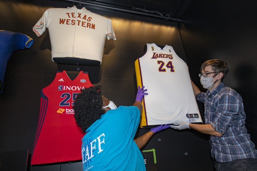Staffers from the National Museum of African American History and Culture install a Kobe Bryant jersey in October 2020. (Robert Stewart / National Museum of African American History and Culture via Los Angeles Times)