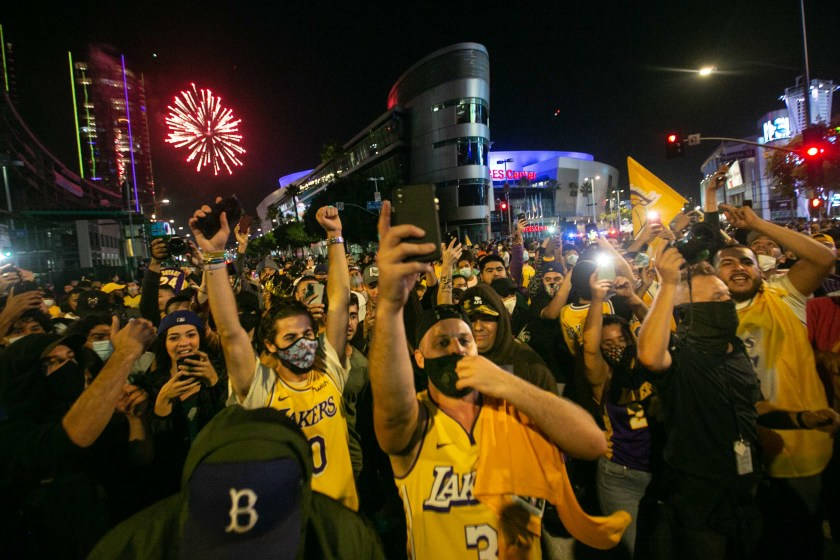 Los Angeles Lakers fans gather near Staples Center in downtown L.A. to celebrate the Lakers NBA Finals win over the Miami Heat on Oct. 11, 2020. (Jason Armond/Los Angeles Times)