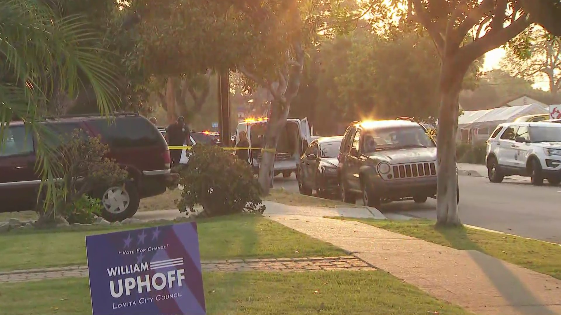 Authorities investigate the deadly shooting of two people in the 2100 block of 255th Street in Lomita on Oct. 4, 2020. (KTLA)
