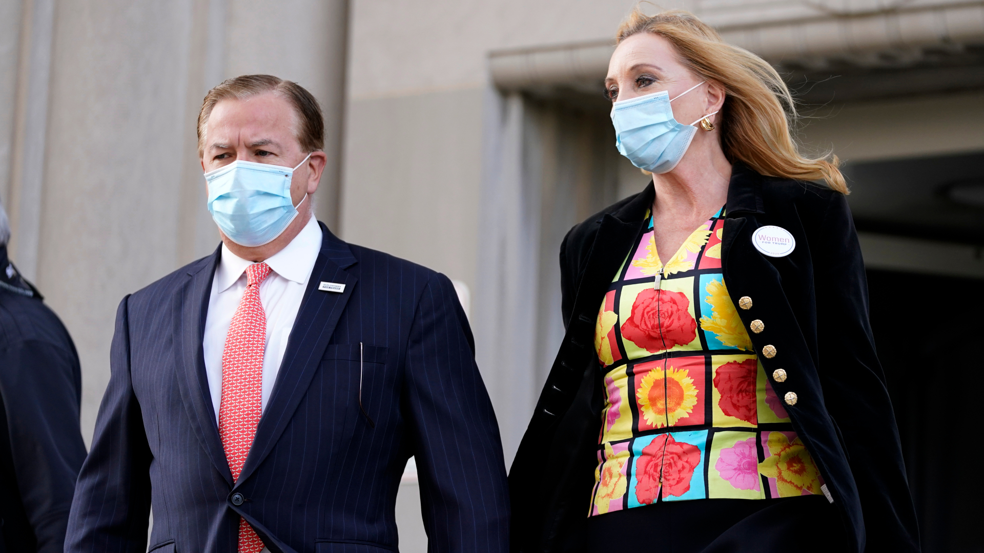 Mark and Patricia McCloskey leave following a court hearing in St. Louis on Oct. 14, 2020. (Jeff Roberson / Associated Press)