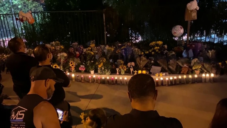 Mourners gathered at a makeshift memorial on Sept. 30, 2020, for two boys who died after being struck by a vehicle in Westlake Village. (KTLA)