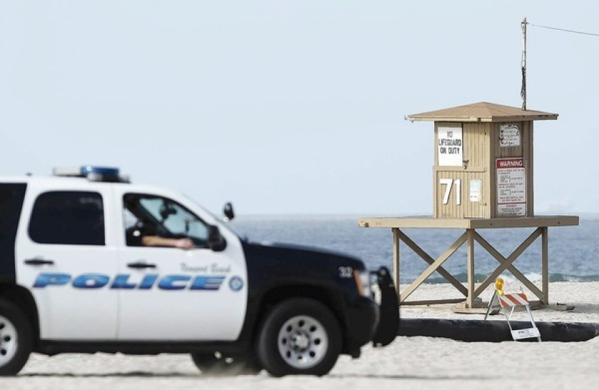 An undated file photo shows a Newport Beach police patrol vehicle at the beach. (Kevin Chang / Times Community News)