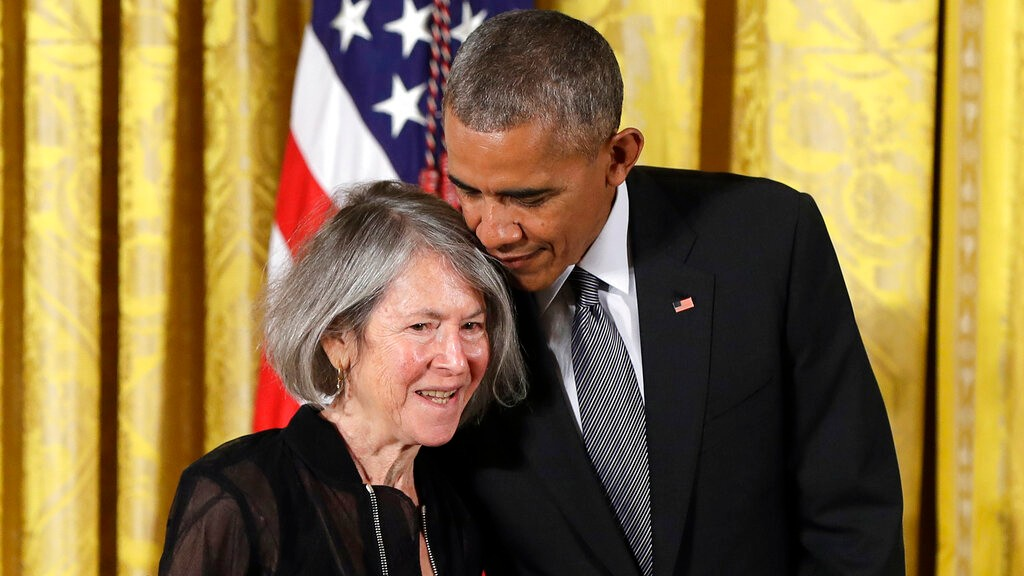 n this Thursday, Sept. 22, 2016 file photo, President Barack Obama embraces poet Louise Gluck before awarding her the 2015 National Humanities Medal during a ceremony in the East Room of the White House, in Washington. (AP Photo/Carolyn Kaster, File)