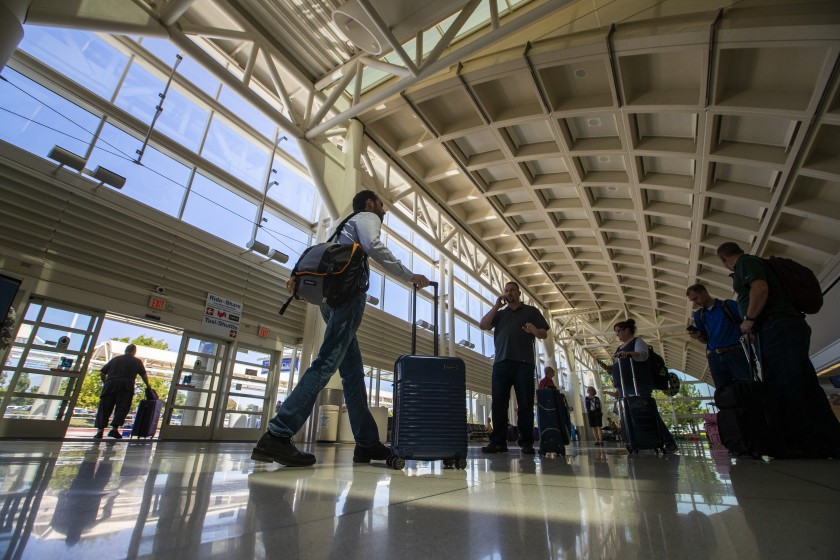 People walk through Ontario International Airport in August 2019. Strong Santa Ana winds have forced the closure of all runways at the airport. (Allen J. Schaben/Los Angeles Times)People walk through Ontario International Airport in August 2019. Strong Santa Ana winds have forced the closure of all runways at the airport. (Allen J. Schaben/Los Angeles Times)