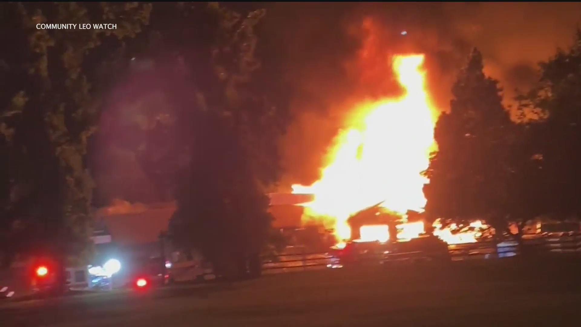 Firefighters battle a blaze at Los Rios Rancho in Oak Glen. (Community Leo Watch)