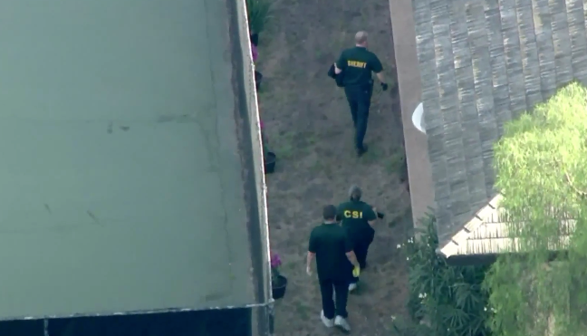 Authorities respond to actor Ron Ely's home in Hope Ranch, California, after the shooting on Oct. 15, 2019. (KTLA)