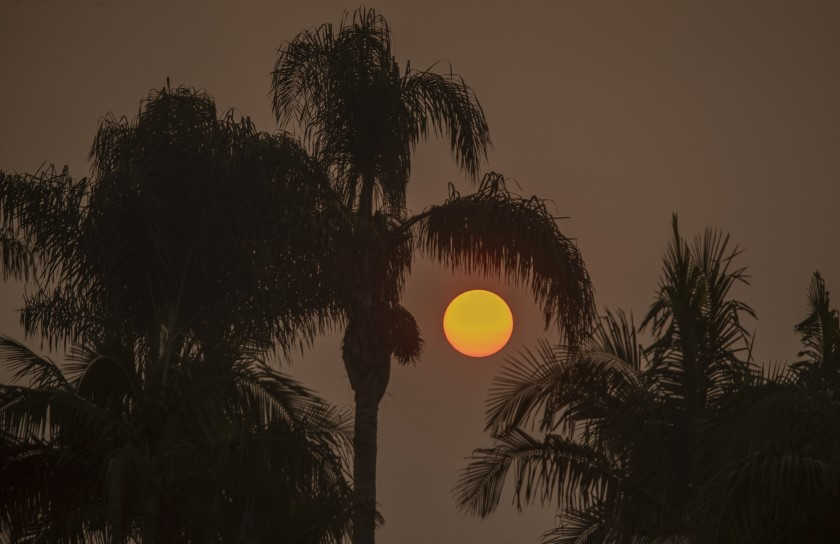The sun is filtered through smoky air from California's record wildfires.(Allen J. Schaben / Los Angeles Times)