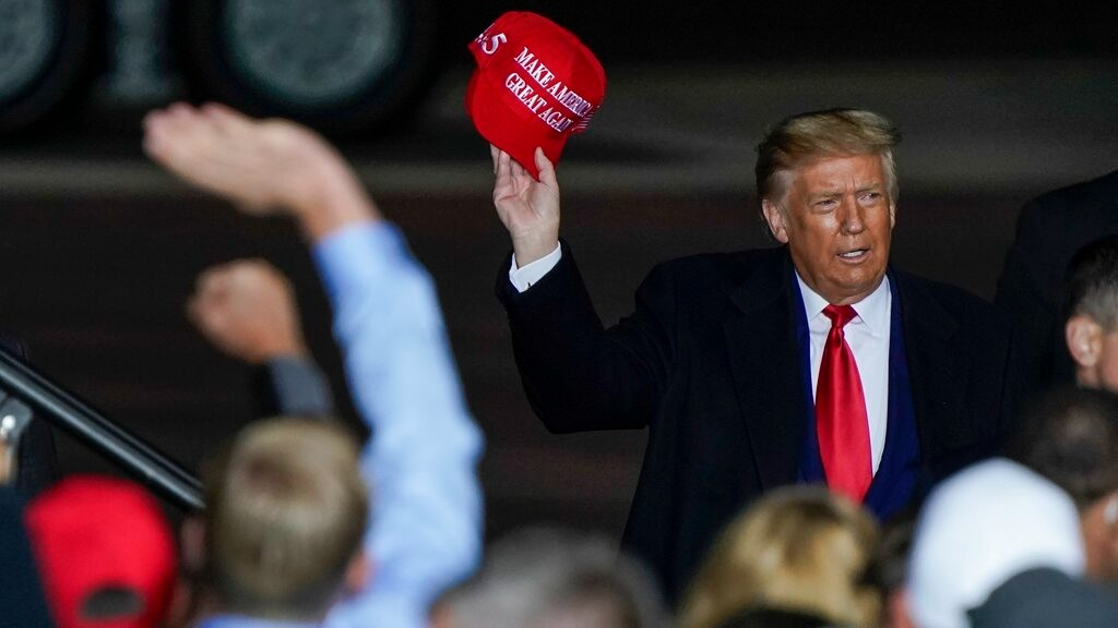 In this Sept. 17, 2020 file photo President Donald Trump throws a hat to the crowd after speaking at a campaign rally at the Central Wisconsin Airport in Mosinee, Wis. (AP Photo/Morry Gash, File)